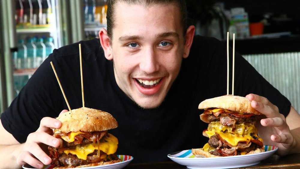 Man Eating Monstrous Burgers