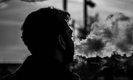 man smoking smoke