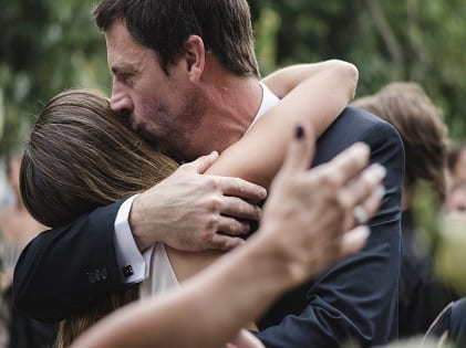 man-and-woman-hugging-while-man-kissing-woman-s-head