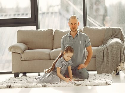 man-in-grey-polo-shirt-sitting-beside-girl-in-grey-checked