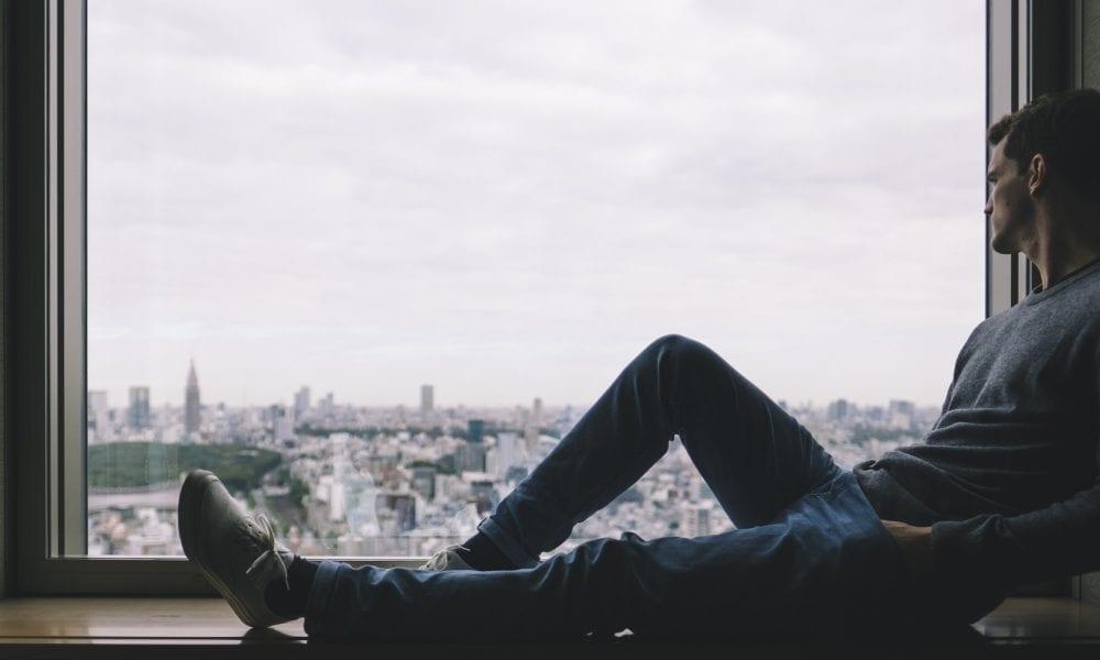 city-man sitting window